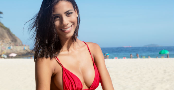 woman in bikini wearing a big smile