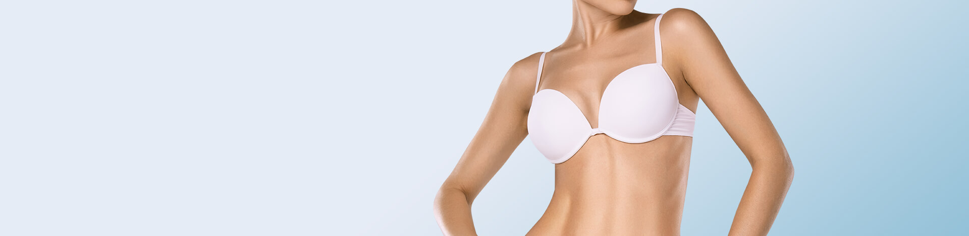 woman posing with youthful look of breasts