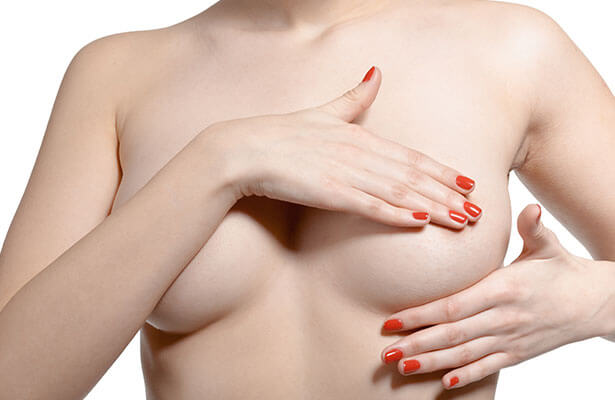 woman covering breast after reduction bowling green ky