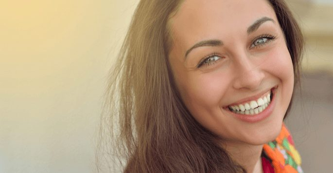 smiling beautiful woman with tantalizing eyes
