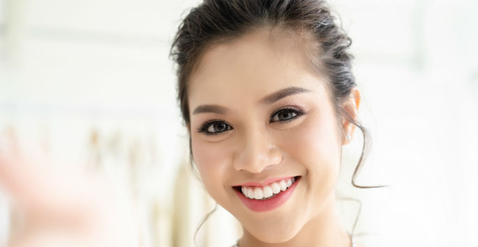 smiling woman after microneedling surgery with PRP
