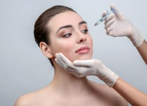 woman to be injected for non-surgical beauty procedure