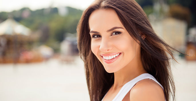 woman smiling after treating wrinkles