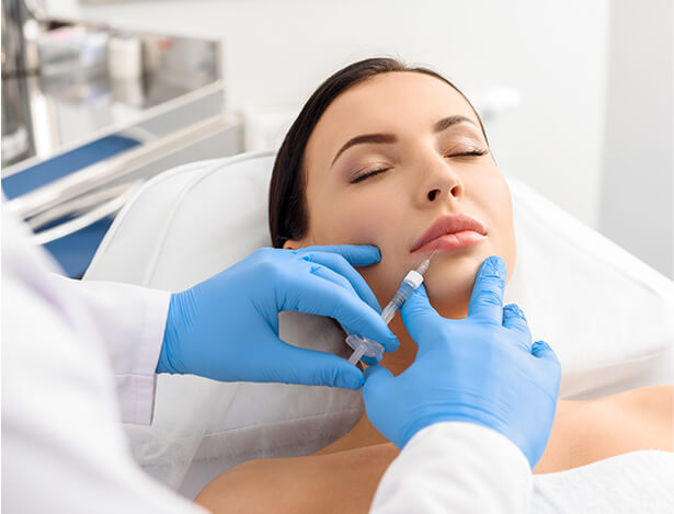 Reclining Woman Receiving Lip Injectables