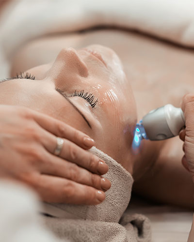 Woman Lying Down Undergoing Face Laser Treatment