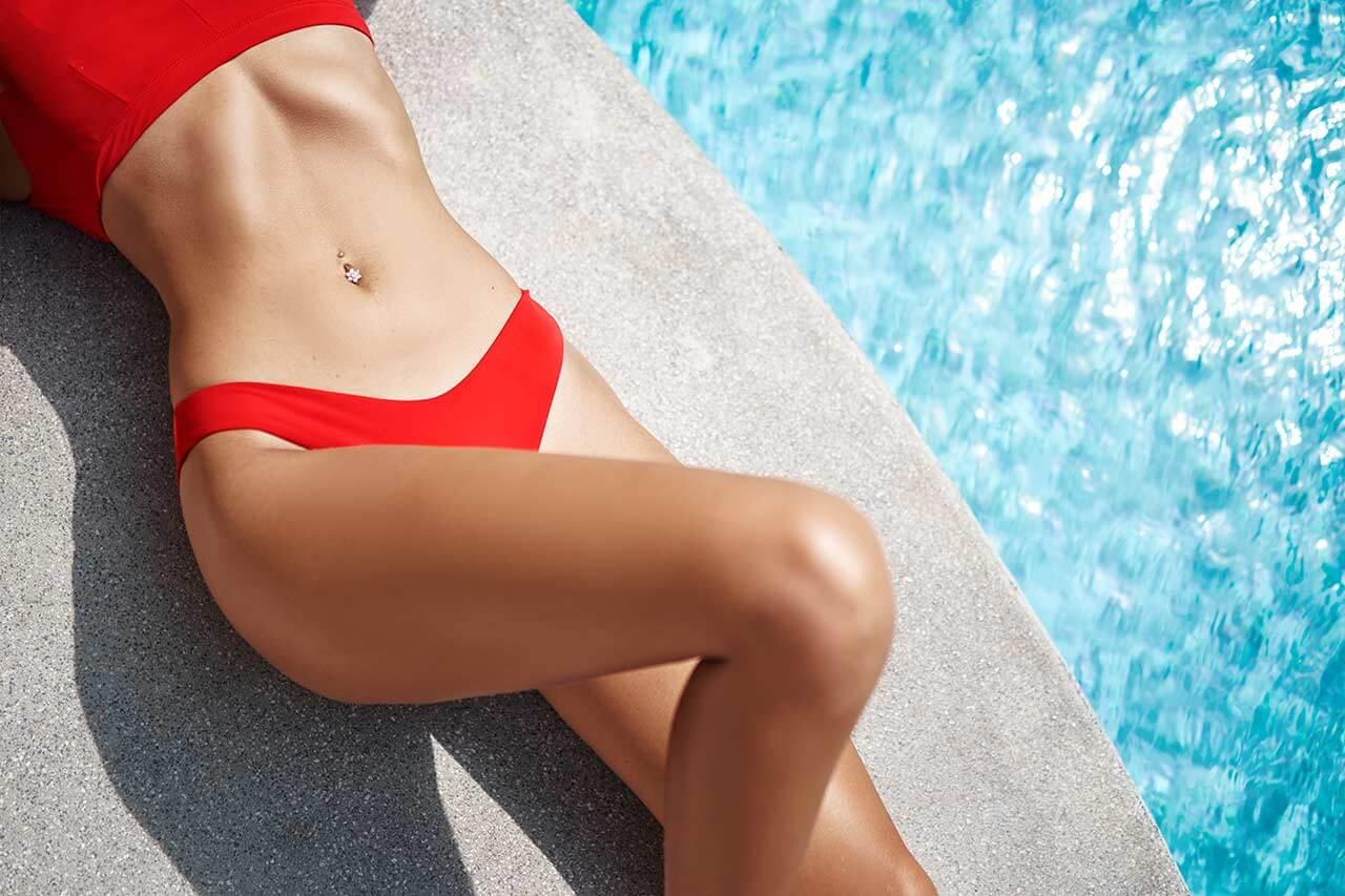 a woman in a red bikini by pool