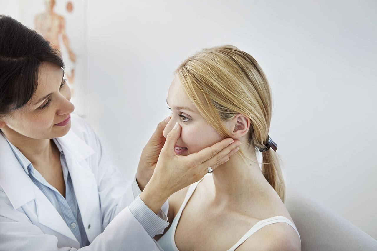woman being examined before plastic surgery
