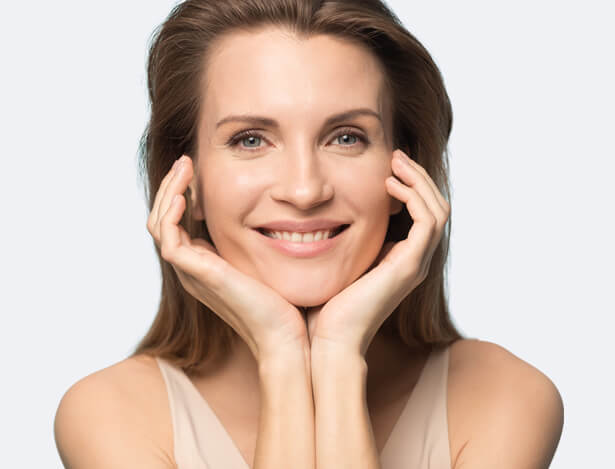 Smiling Woman Resting Chin in Hands
