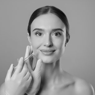 Woman Smiling While Recieving Face Injections