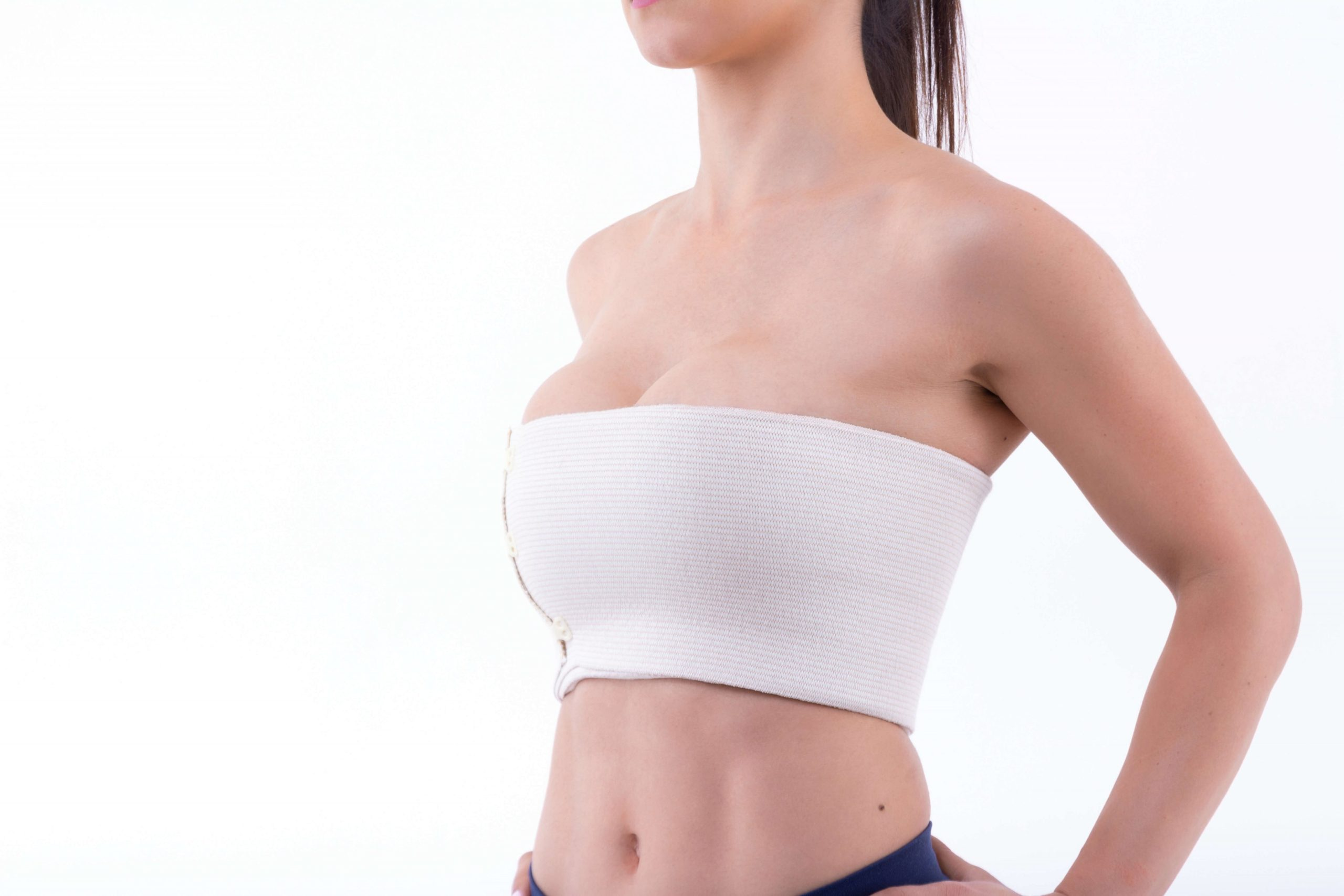 woman after breast augmentation procedure scaled