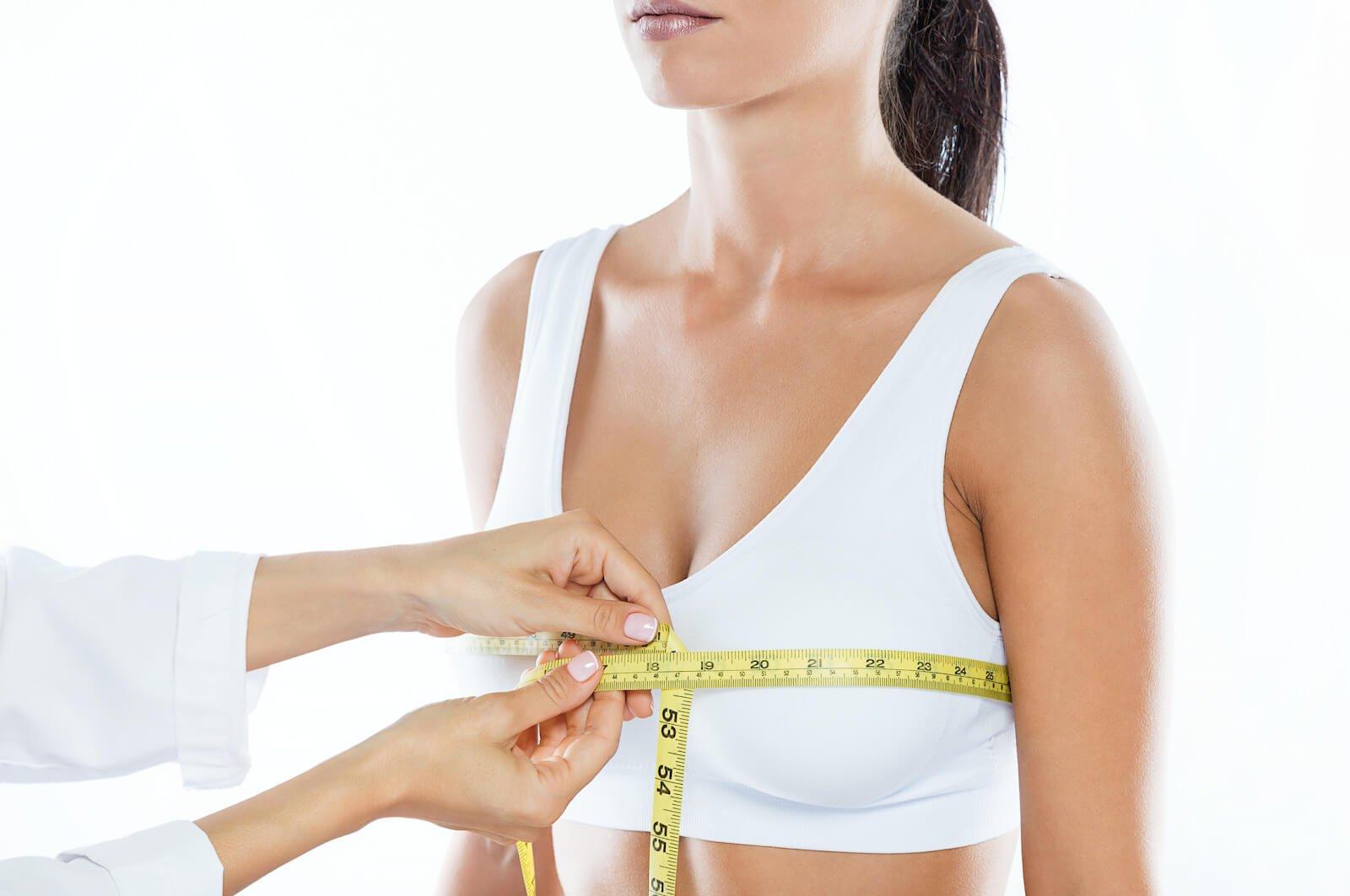 woman having her breasts measured
