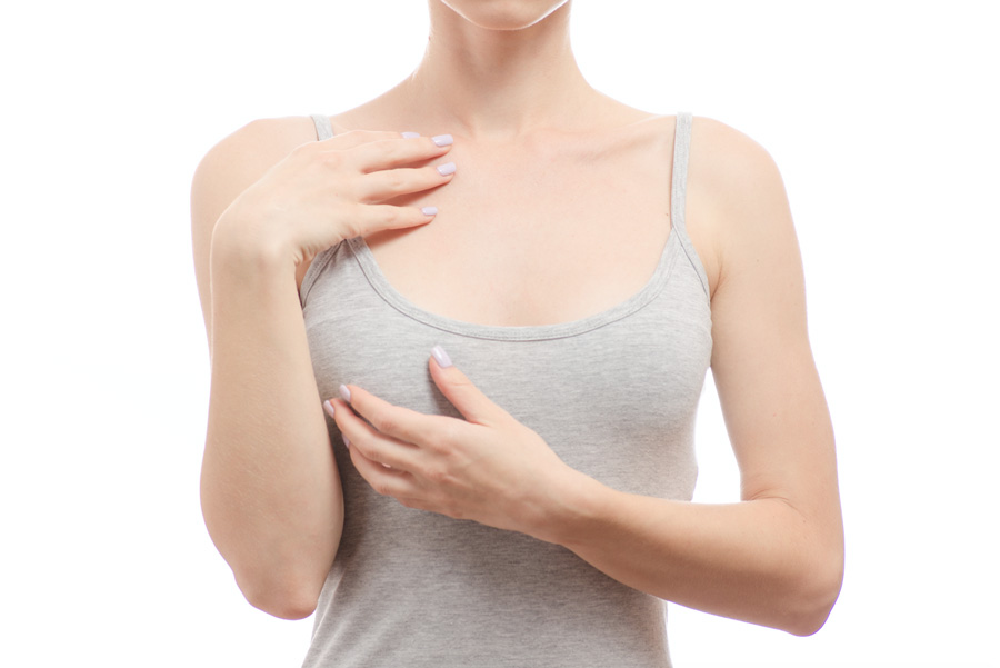 close-up of woman's chest wearing grey tank top