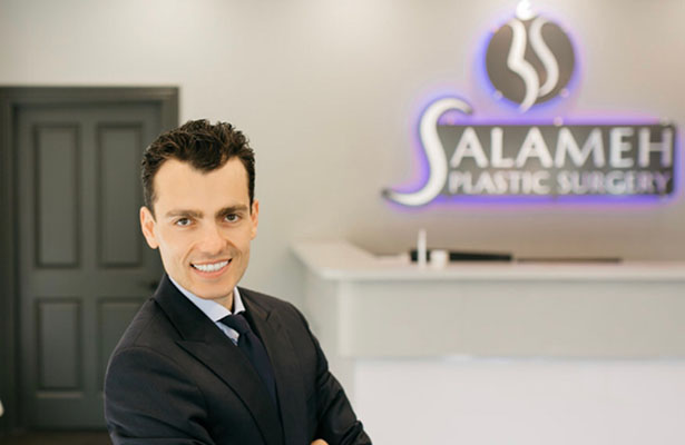 Dr Salameh on great suit smiling in front of camera