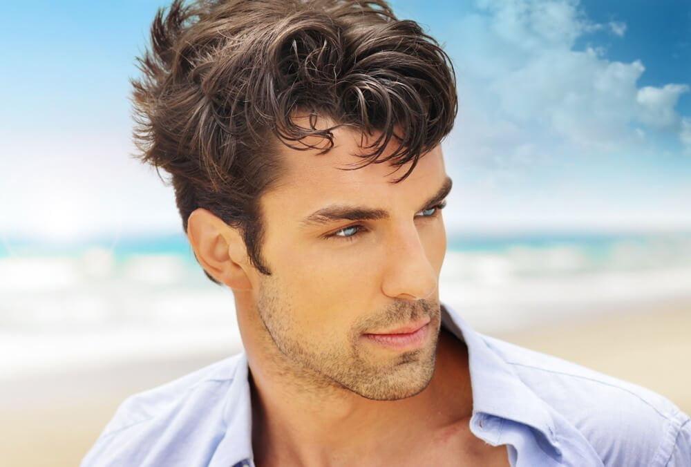 Man with great hair on beach
