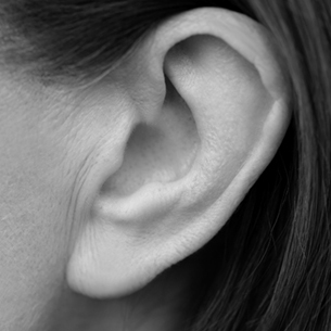 Black and White Photo of Woman's Ear