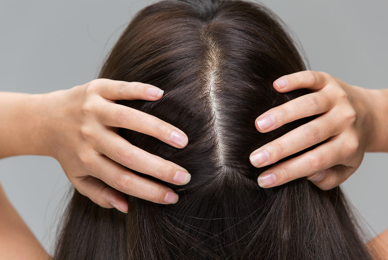 Woman parting her hair