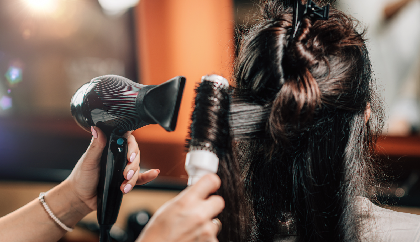 Woman sitting for hair styling