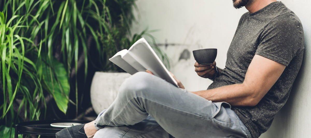 a man reading a paper