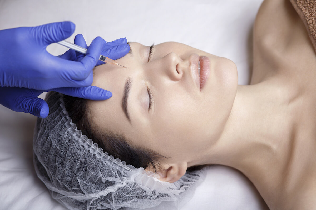 a woman receiving injectables