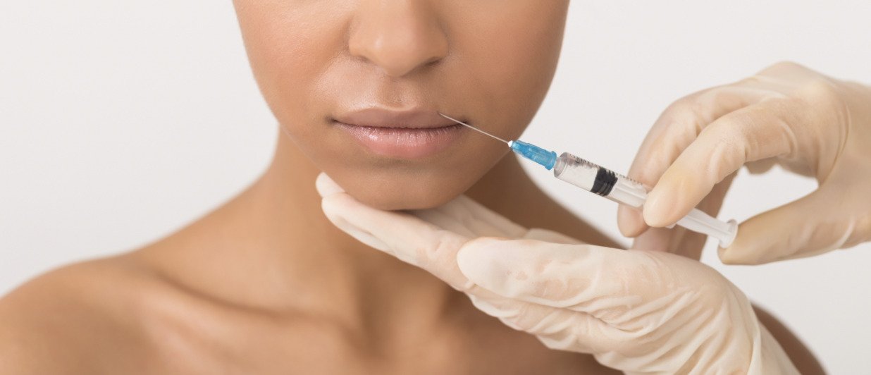 a woman receiving lip injections