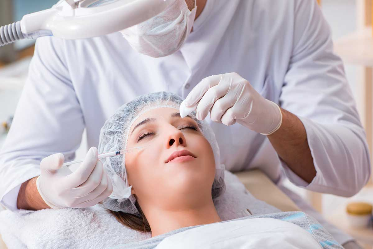 a woman receiving Botox injections