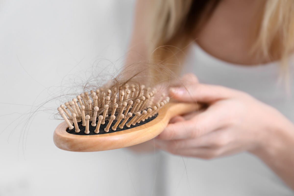 A brush with lots of hair in it