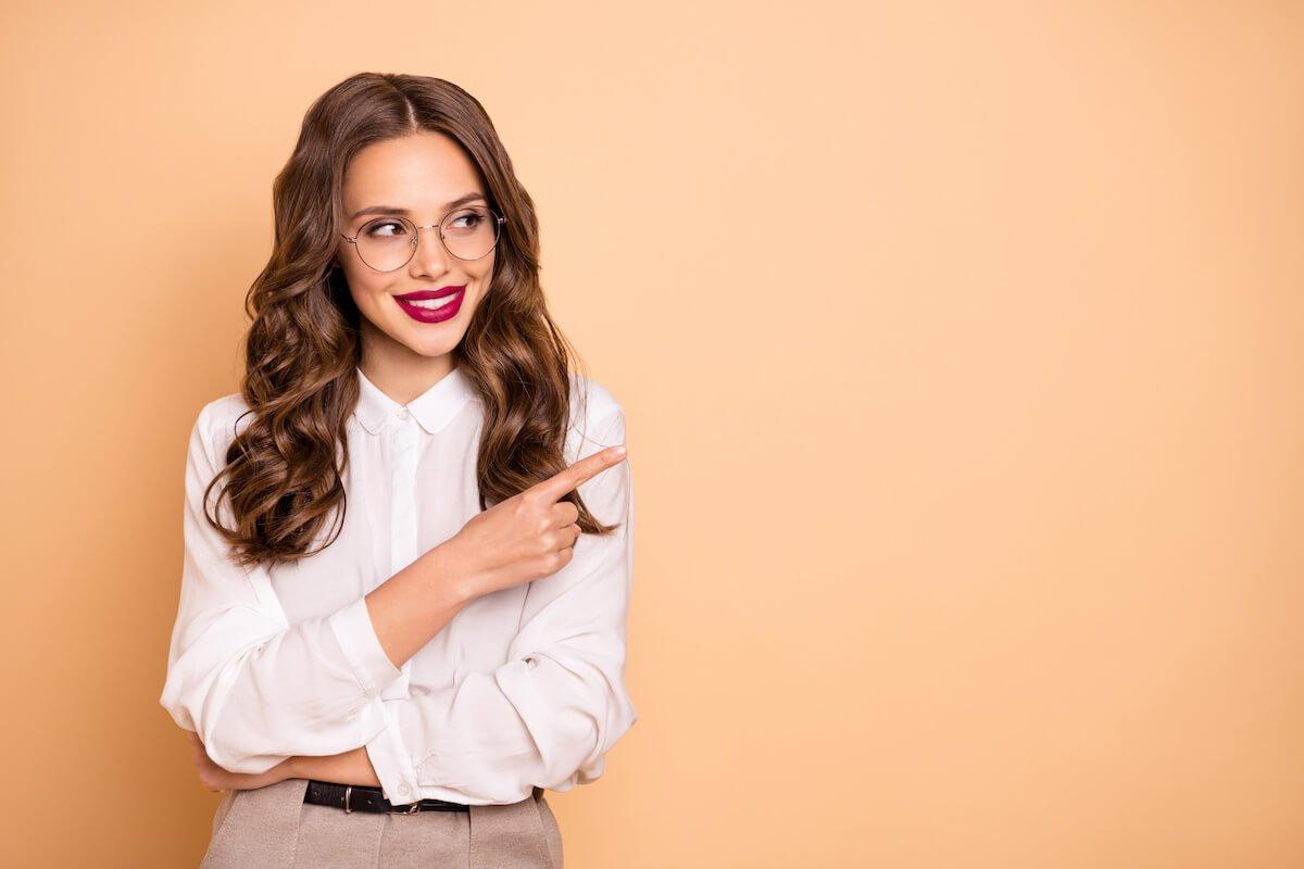 Gorgeous businesswoman pointing