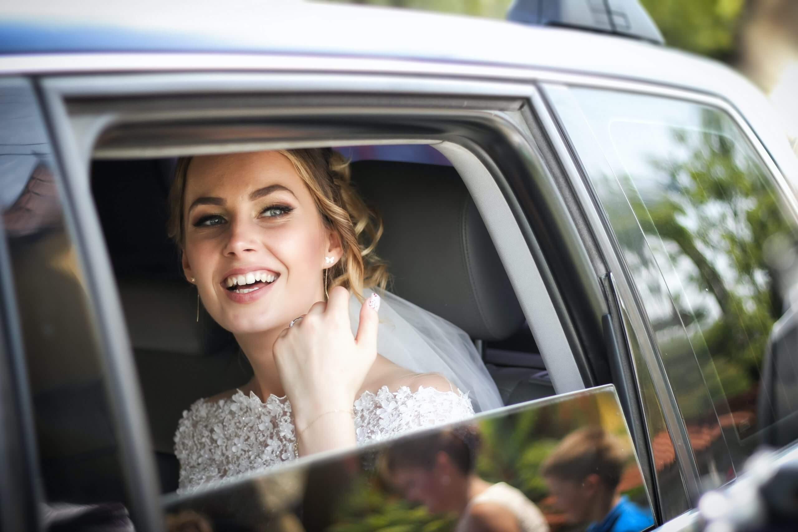 smiling bride in a limo
