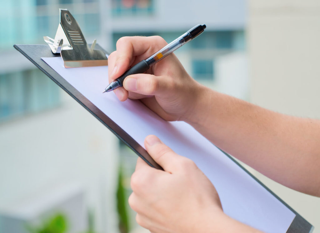 Person creating a checklist to prepare for cosmetic surgery