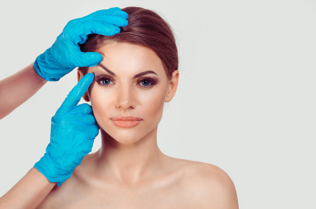 a woman prepares for blepharoplasty
