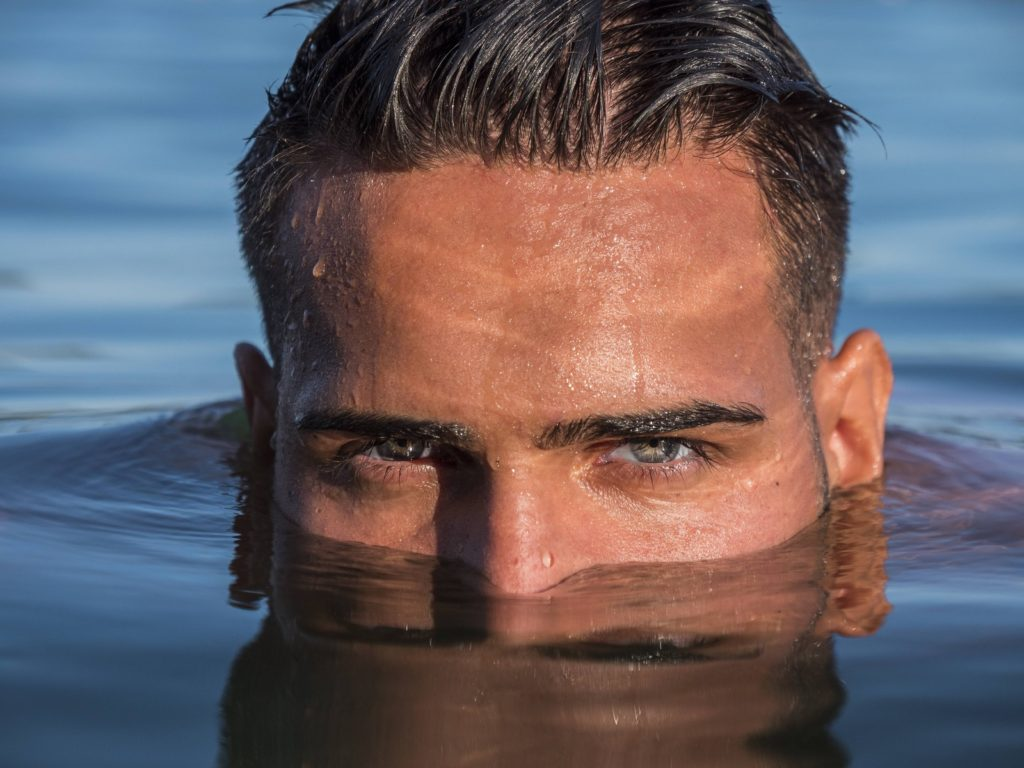 Man in the water who knows the hair transplant success rate