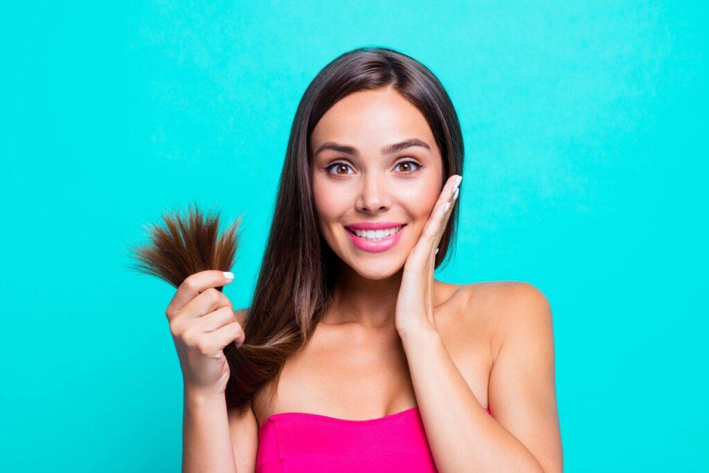 Woman checking for normal hair loss